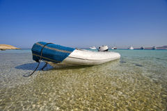 Small boat in lagoon. Inflatable boat beached in sandy lagoon Royalty Free Stock Images