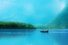 Small boat on a lake in the Alps Stock Photography