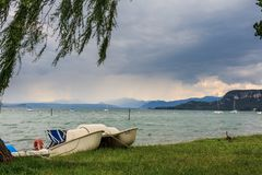 Small boat at the Lago di Garda royalty free stock image