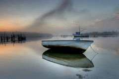 Small boat at low tide Stock Image