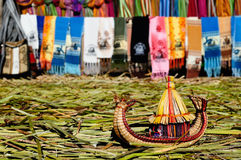 Small boat made from grass totora reeds, Titicaca lake, Peru Stock Photos
