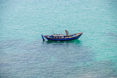 Lonely Fisherman in the sea, Vietnam 2 royalty free stock photo