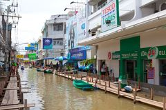 Small boat during the monsoon flooding in Thailand Royalty Free Stock Photo