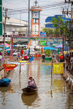 Small boat during the monsoon flooding in Thailand Royalty Free Stock Image