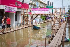 Small boat during the monsoon flooding in Thailand Stock Photography