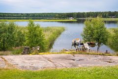 Small boat moored by the jetty Stock Image
