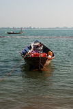 Small boat moored in ocean water Royalty Free Stock Image
