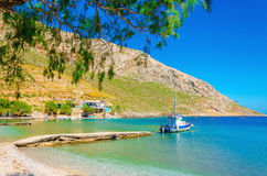 Small boat moored in peaceful bay with clear sand. Small boat moored in peaceful bay  with clear sand, Greece Royalty Free Stock Image