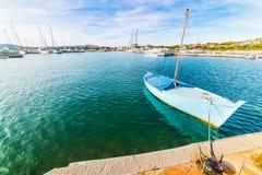 Small boat moored in Porto Rotondo harbor. Costa Smeralda, Sardinia royalty free stock images