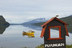 Tranquility of Patagonia at Puyuhuapi, Chile. Small boat moored on the still waters of a sea loch at Puyuhuapi, a small town on the Carretera Austral in northern Stock Photography
