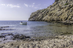 Small boat moored in a tranquil bay Stock Photo
