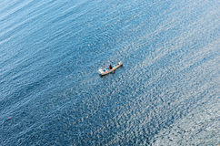 Small boat near of Isla del Sol, island on lake Titicaca in Bolivia Stock Photography