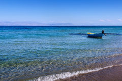 Small boat near the shore on the mediterranean sea Stock Images
