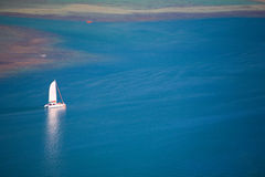 Small boat in ocean Royalty Free Stock Photography