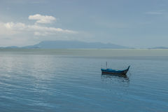 A small boat in ocean Royalty Free Stock Photography