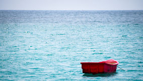 Small boat at ocean. Small boat in vast sea Royalty Free Stock Photography