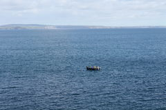 A Small Boat Off the Coast of Cornwall Royalty Free Stock Photo