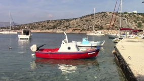 Small boat. Old small fishing boat in Schinoussa island port stock footage