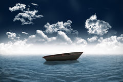 Small boat in open sea Royalty Free Stock Image