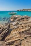Small boat in Paranga Beach on the island of Mykonos, Greece Royalty Free Stock Photos