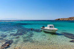 Small boat in Paranga Beach on the island of Mykonos, Greece Royalty Free Stock Photography