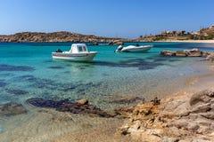 Small boat in Paranga Beach on the island of Mykonos, Greece Stock Photography