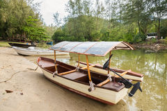 The small boat parked in a small canal at the mangrove forest.Th Royalty Free Stock Photo