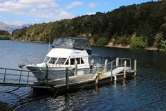 Small boat, Pearl Harbour, Waiau River, Manapouri stock image
