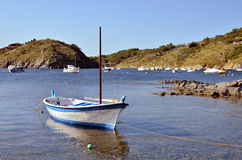 Small boat at Port Lligat in Spain Stock Image