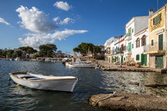 Small boat in Porto Colom. Small white boat at Porto Colom boat harbour on the island of Mallorca on a sunny day Royalty Free Stock Images