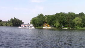 Small boat. Small recreation boat floating on a park lake stock video footage