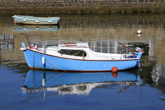 Small boat and reflection in the sea Royalty Free Stock Photo