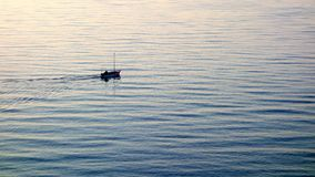 Small Boat on Rippled Water Royalty Free Stock Image