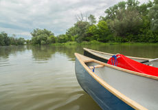 Small boat on river Stock Photography