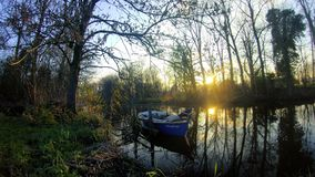 Small boat on the river stock footage