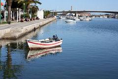 A small boat on the river at Tavira, Portugal Royalty Free Stock Photo