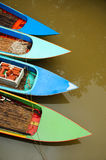 Small boat in river Stock Photos