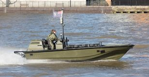 Small boat of the Royal Navy practicing on the Thames on februari 21, 2019. London, United Kingdom - Februari 21, 2019: Small boat of the Royal Navy practicing royalty free stock photography