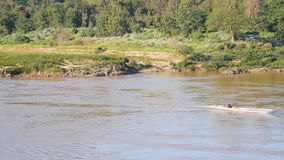 The small boat sailed along the river stock footage