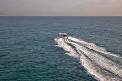 Small boat sailing through a calm sea Royalty Free Stock Photos