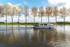 Small boat sailing on the canal Royalty Free Stock Photo