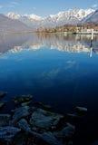 Small boat sailing in Como Lake, Italy Stock Image