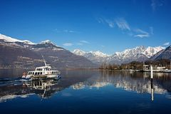 Small boat sailing in Como Lake, Italy Royalty Free Stock Images