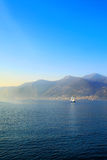 Small boat sailing on Iseo Lake, Italy. Panoramic view on Iseo Lake, Italy stock images
