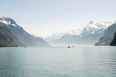 Small boat sailing on Lake Lucerne near Brunnen in Switzerland stock photo