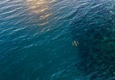 Small boat sailing in the ocean from above