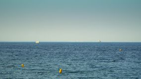 A small boat sailing sails on the sea stock video footage
