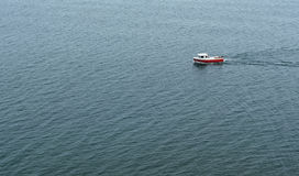 Small boat sailing on the sea. Royalty Free Stock Photo