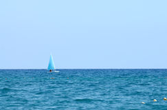 A small boat sailing on a sunny day. Turkey, Antalya, Kemer Royalty Free Stock Photos