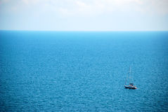 Small boat at sea. Small boat floating on the sea Stock Image